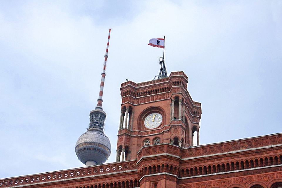 A picture of the Red Town Hall with the Berlin TV Tower in the background
